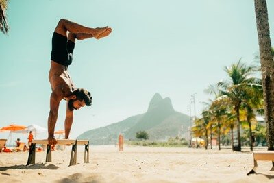 handstand at beach