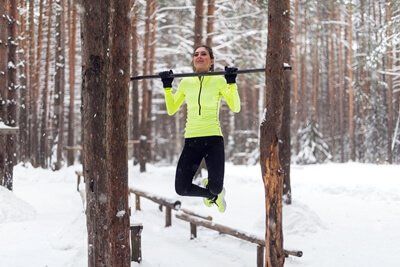 outdoor pull up bar between trees
